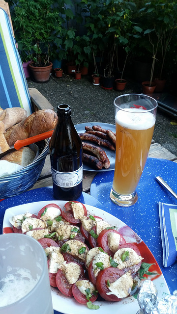 tomato and cheese salad, bread, sausages, and a hearty Franconian beer