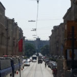 trams in the middle of the street; cars, bikes, and pedestrians have their own lanes